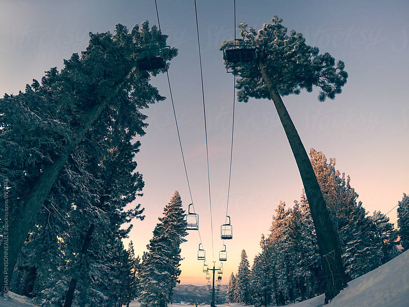 Dreamy Sunset with Chair Lift and Snowy Trees by MEGHAN PINSONNEAULT for Stocksy United