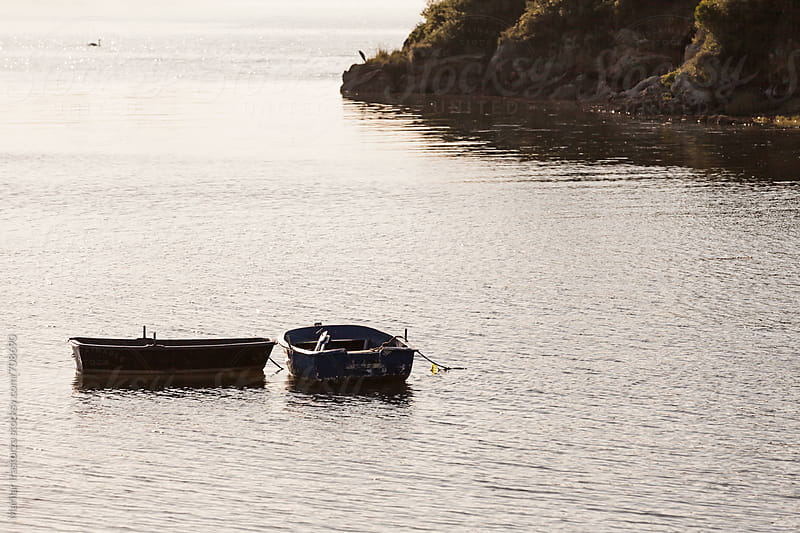 Boats at sunset by Marilar Irastorza for Stocksy United