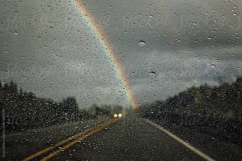 Rain Droplets on Windshield with Rainbow by Evan Dalen for Stocksy United