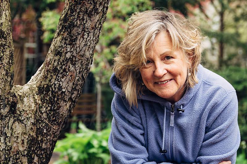 Portrait of a mature gardening woman by Gabriel (Gabi) Bucataru for Stocksy United