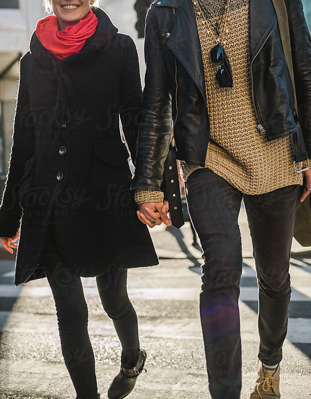 Young couple walking in the city by GIC for Stocksy United