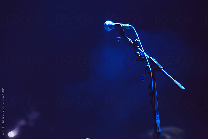 Microphone on stage with lights by Robert Kohlhuber for Stocksy United