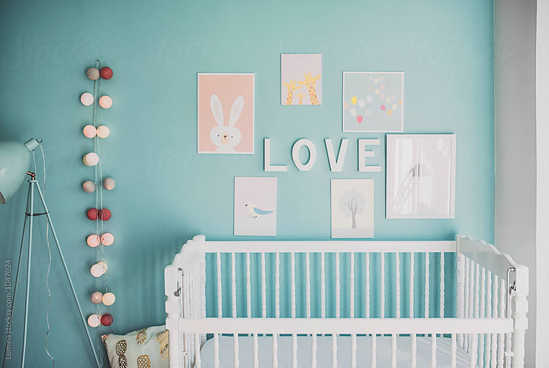 Turquoise Nursery With a Crib by Lumina for Stocksy United