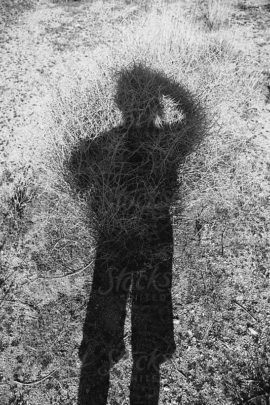 Shadow of photographer taking self portrait by Paul Edmondson for Stocksy United