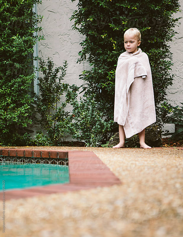Boy in towel after the pool by Stephen Morris for Stocksy United