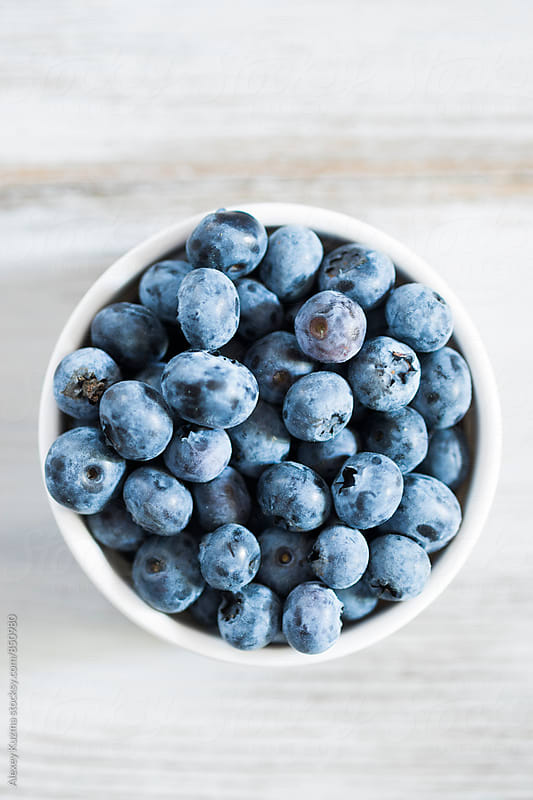 blueberries in a white bowl. by Alexey Kuzma for Stocksy United