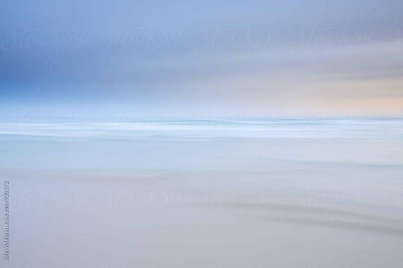 Blur of the ocean. by John White for Stocksy United