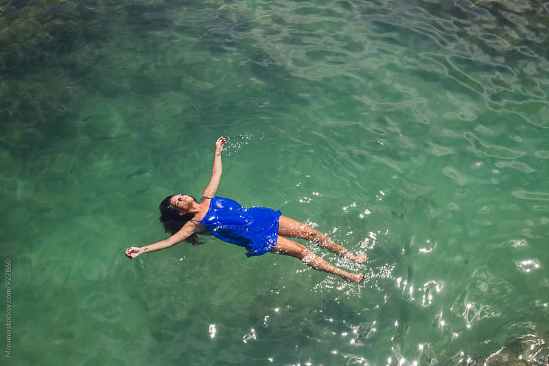 Young woman swimming in the sea by Mosuno for Stocksy United