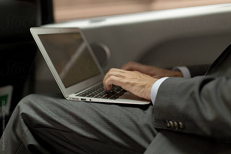 Caucasian business man typing on his laptop by Eddie Pearson for Stocksy United