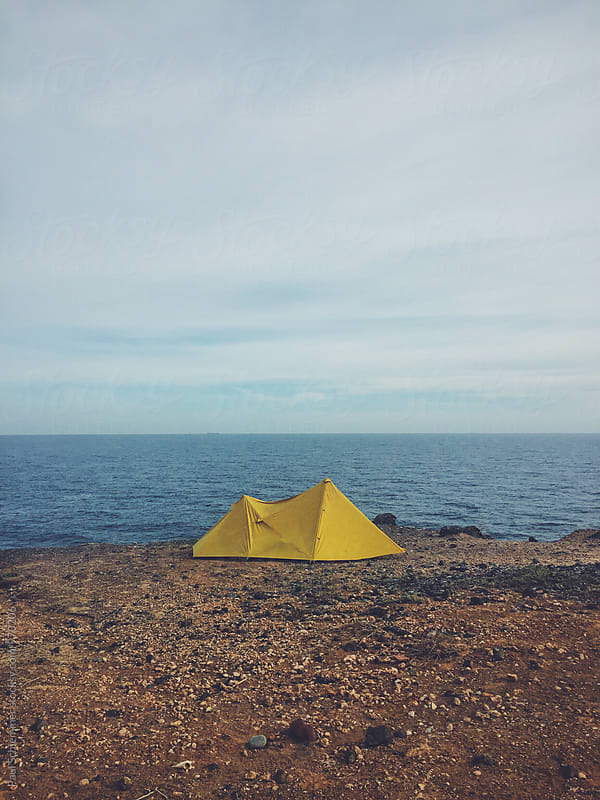 yellow tent by Paul Schlemmer for Stocksy United