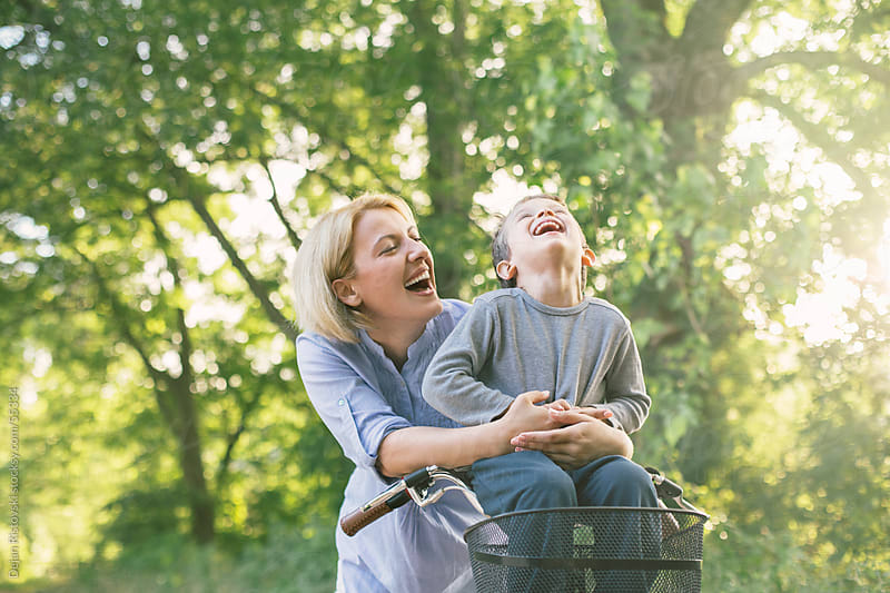Mother and son laughing together by Dejan Ristovski for Stocksy United