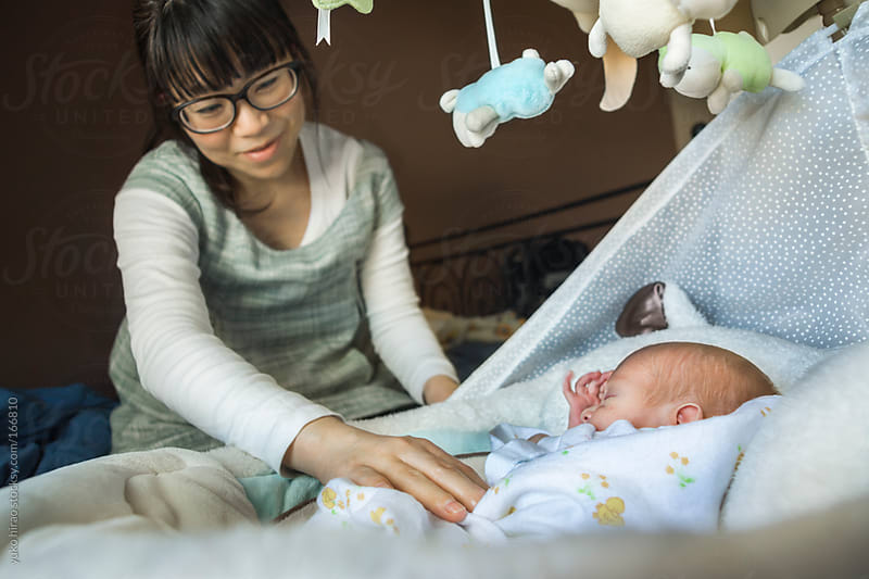 happy Asian mother and newborn baby by yuko hirao for Stocksy United