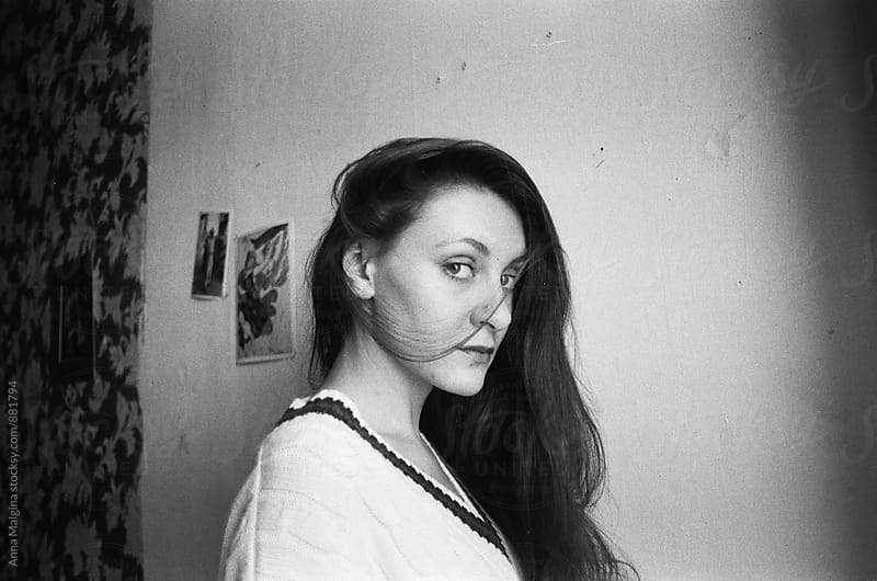 A black and white film photo of a young beautiful woman  by Anna Malgina for Stocksy United