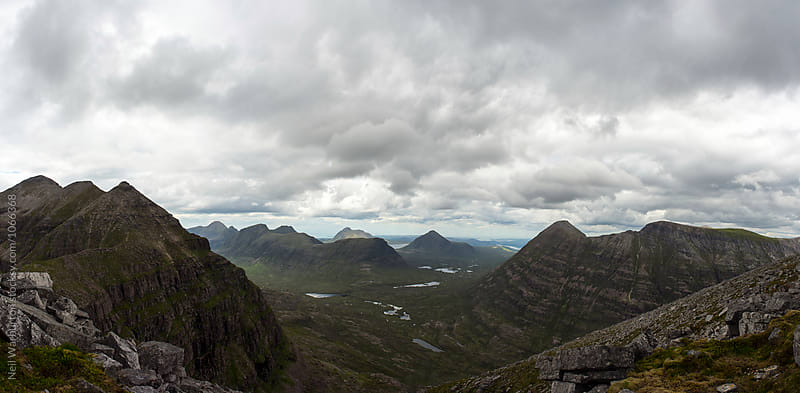 Panoramic view from the summit of a Scottish Mountain by Neil Warburton for Stocksy United