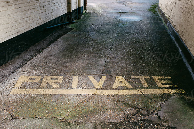 Hand painted 'private' road sign on an allyway. Norfok, UK. by Liam Grant for Stocksy United