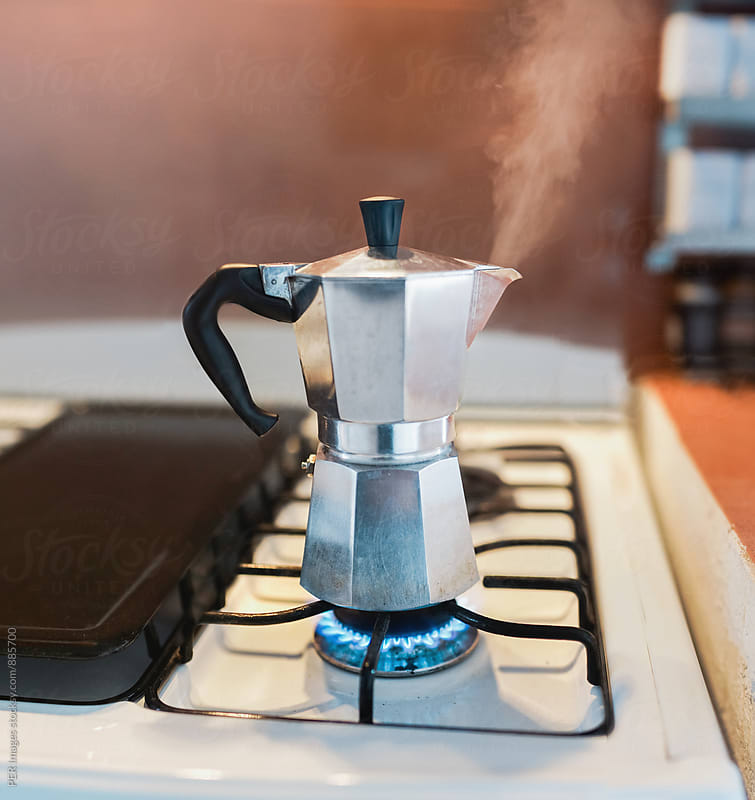 Steaming Italian coffee percolator on gas stove by Per Swantesson for Stocksy United