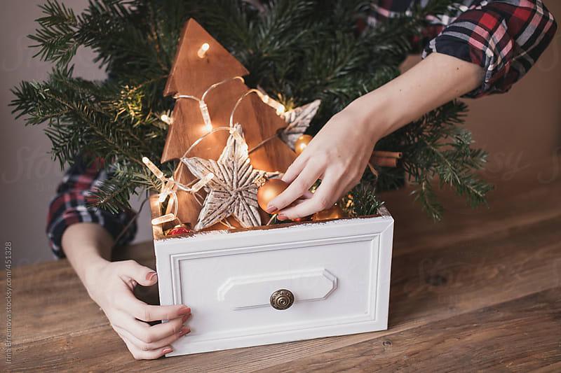 Putting together Christmas by Irina Efremova for Stocksy United