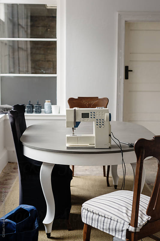 sewing machine set up on a table by Gillian Vann for Stocksy United