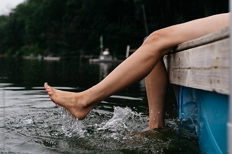 Female's legs splashing by Gabriel (Gabi) Bucataru for Stocksy United