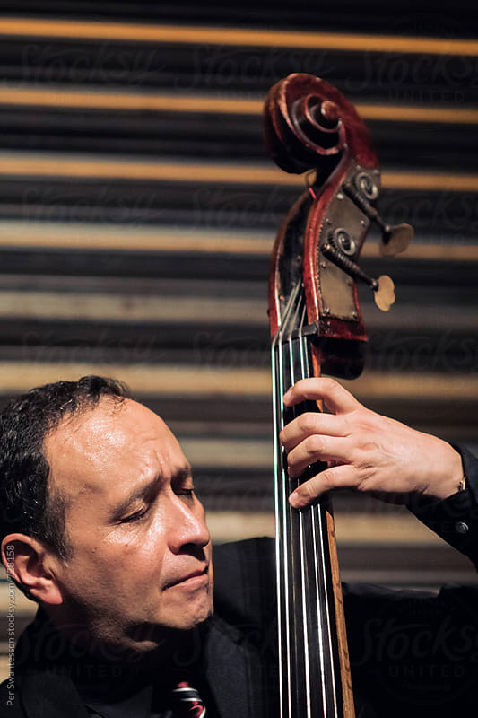 Portrait of double bass musician by Per Swantesson for Stocksy United