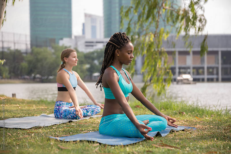 Yoga in a park  by Jovo Jovanovic for Stocksy United