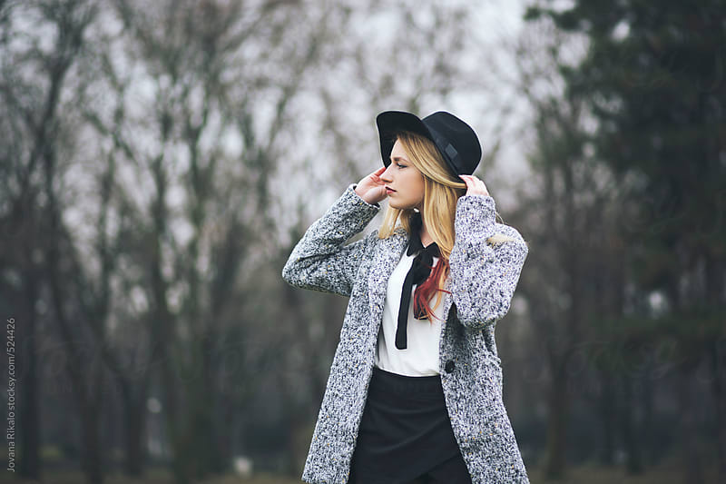 Portrait of a fashionable young woman by Jovana Rikalo for Stocksy United