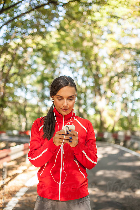 Female Runner Using Technology by Mosuno for Stocksy United