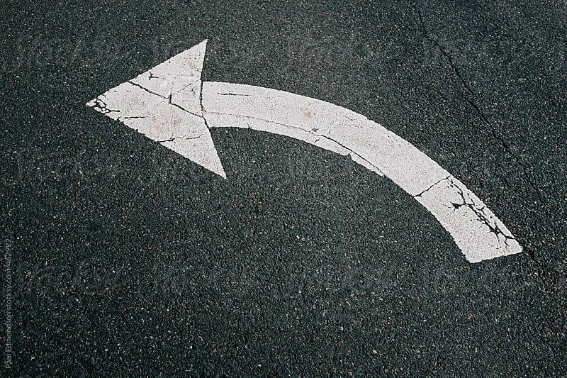 Painted arrow on street by Paul Edmondson for Stocksy United