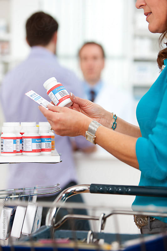 Pharmacy: Holding Medicine and Coupon by Sean Locke for Stocksy United