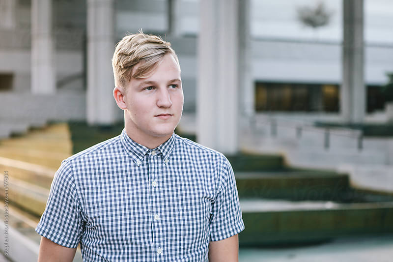 Young Man Portrait Downtown by Stephen Morris for Stocksy United