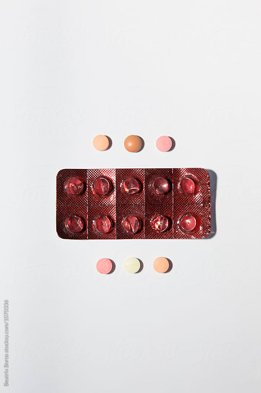Blister pack with 6 coloured pills by Beatrix Boros for Stocksy United