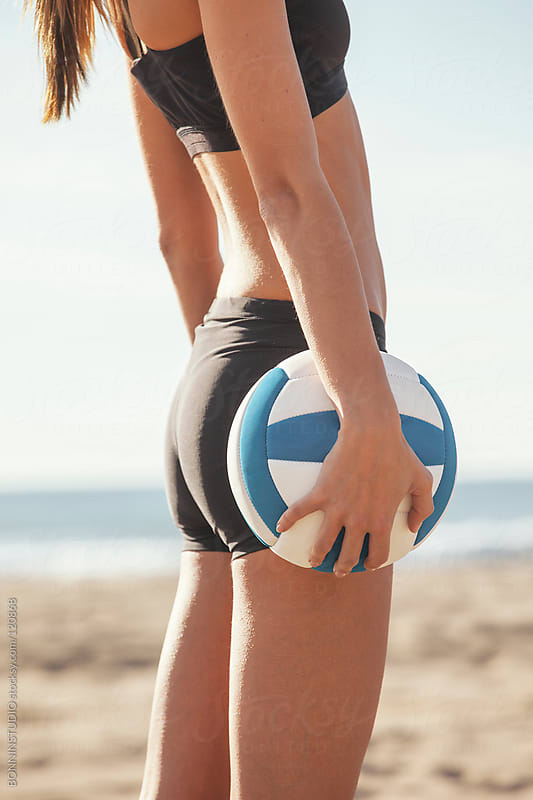 Beach volleyball. Close up of sporty woman standing with ball. by BONNINSTUDIO for Stocksy United
