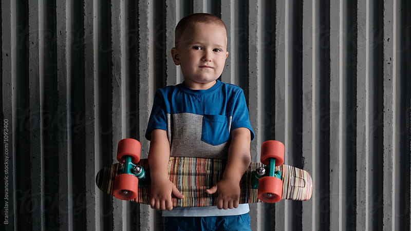 Portrait of a Little Boy with Skateboard by Branislav Jovanovic for Stocksy United