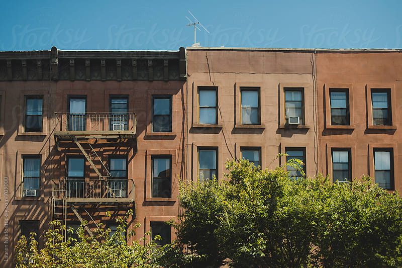 Brownstone apartment buildings by Lauren Naefe for Stocksy United