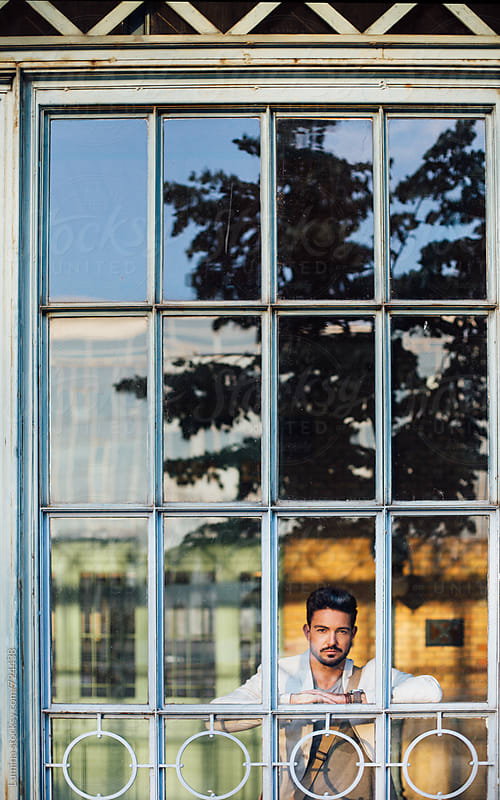 Modern Man Standing at a Big Window by Lumina for Stocksy United