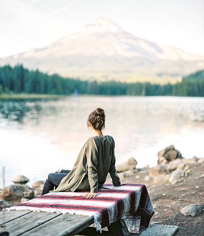 Woman taking in mountain view at lake by Daniel Kim Photography for Stocksy United