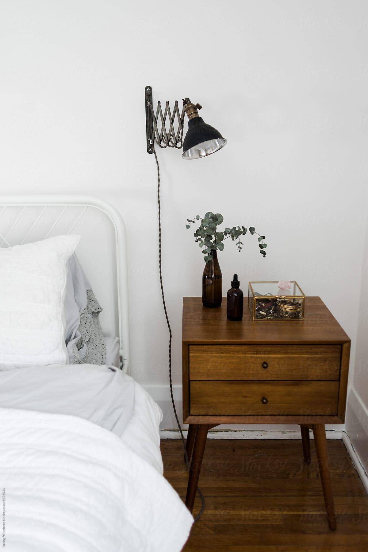 Minimalist bedside table in Scandinavian white bedroom by ...