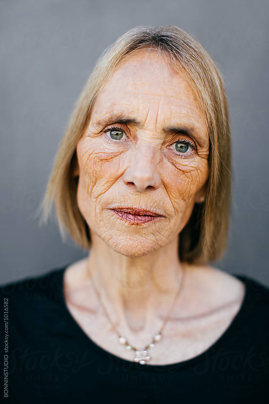 Closeup portrait of a wrinkled senior woman. by BONNINSTUDIO for Stocksy United