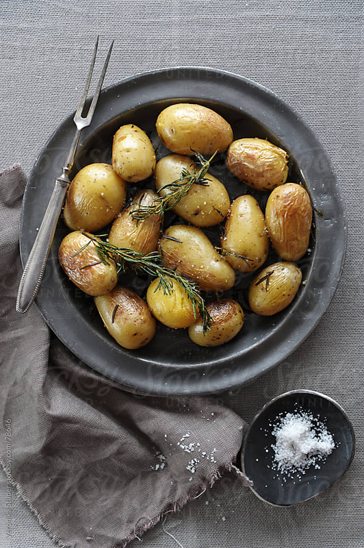 Rosemary potatoes by Veronika Studer for Stocksy United