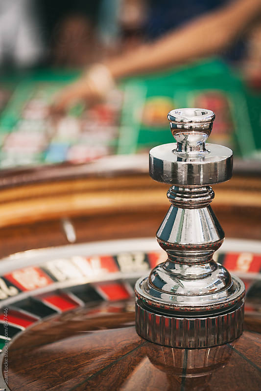 Casino: Roulette Wheel Waits As People Bet On Table by Sean Locke for Stocksy United