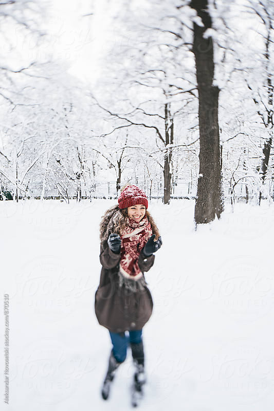 Beautiful woman enjoying winter in the park by Aleksandar Novoselski for Stocksy United