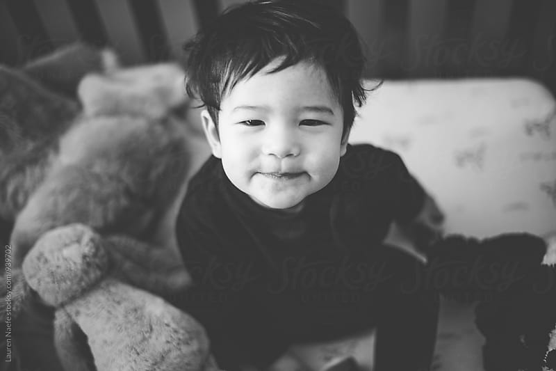 Little boy smiling at camera by Lauren Naefe for Stocksy United