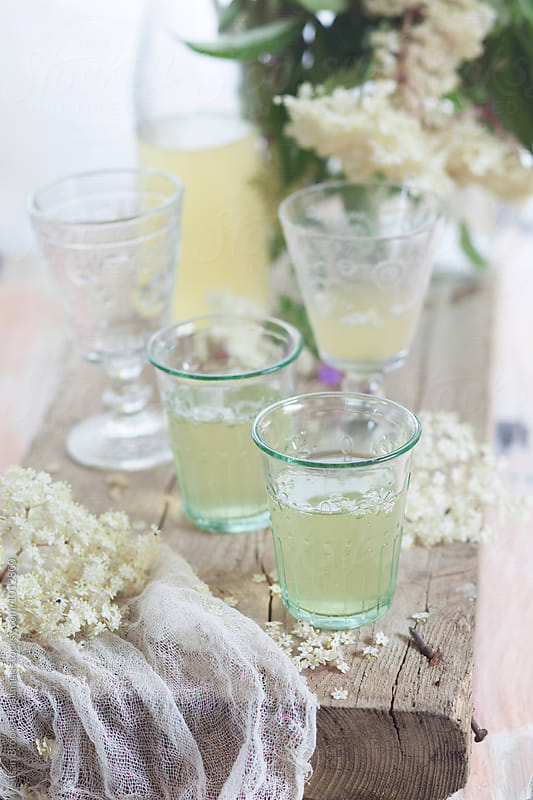 elderflower champagne  by Susan Brooks-Dammann for Stocksy United