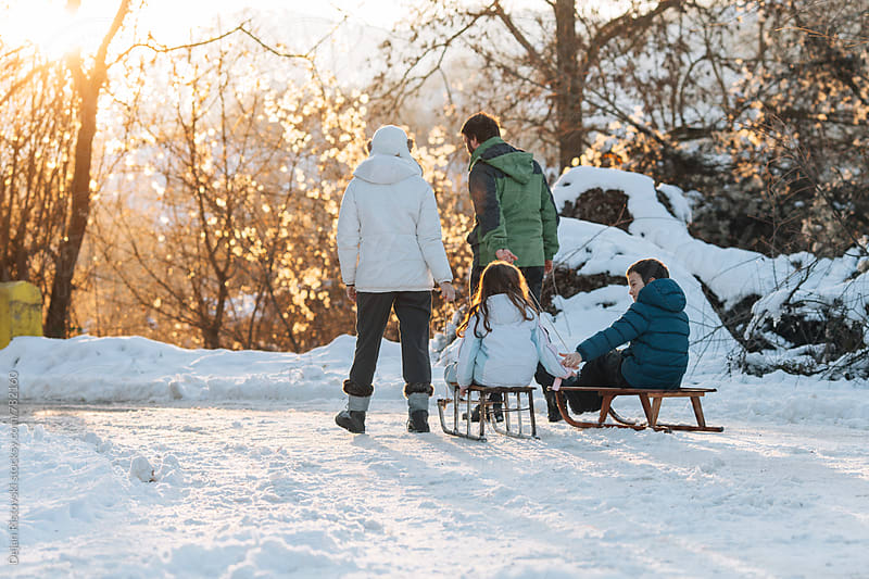 Family on snow. by Dejan Ristovski for Stocksy United