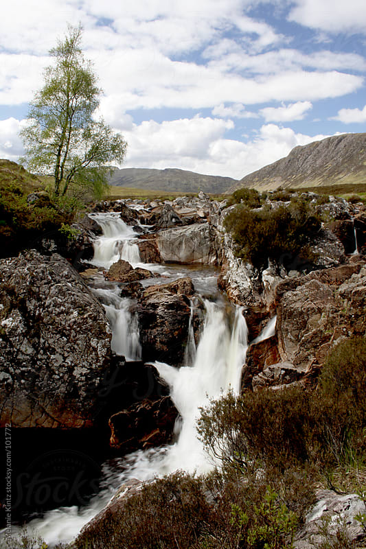 The waterfall at Glen Etive in the Scottish Highlands  by Melanie Kintz for Stocksy United