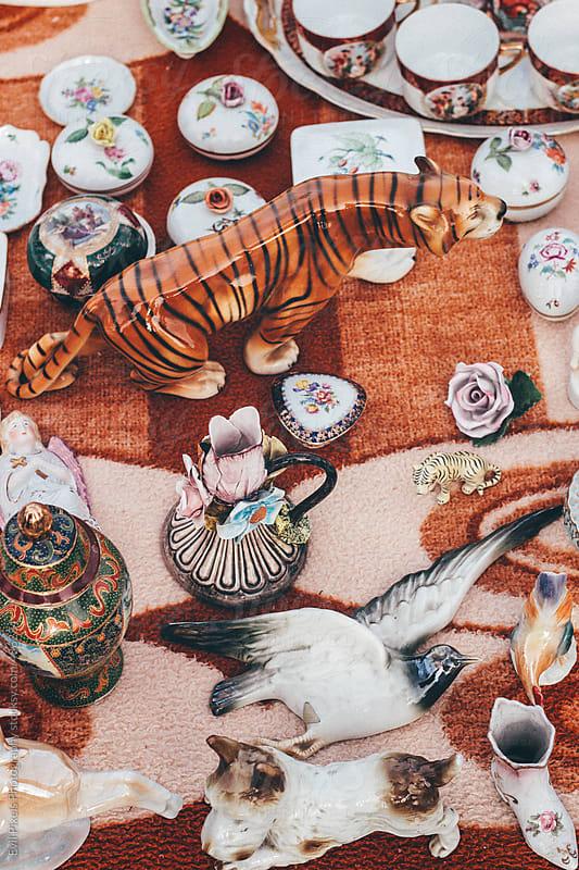 Porcelain figures on the vintage market  by Evil Pixels Photography for Stocksy United