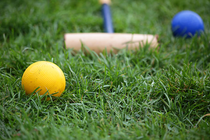 Vintage Croquet Balls In A Green Lawn Ready For Play by ALICIA BOCK for Stocksy United