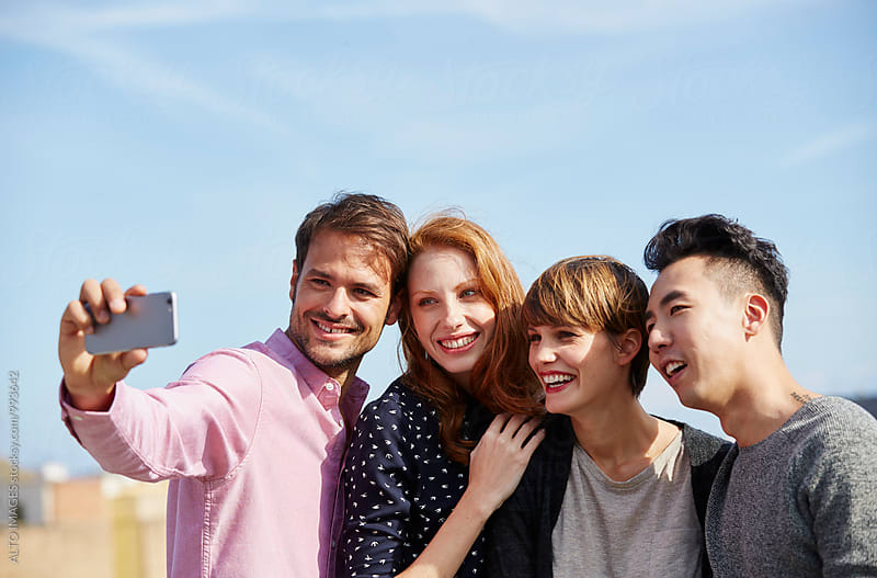 Happy Man Talking Selfie With Friends by ALTO IMAGES for Stocksy United