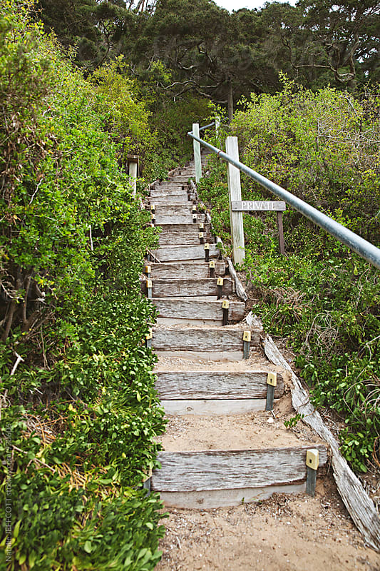 Stairs on the beach leading to a private property in Portsea, Victoria, Australia by Natalie JEFFCOTT for Stocksy United