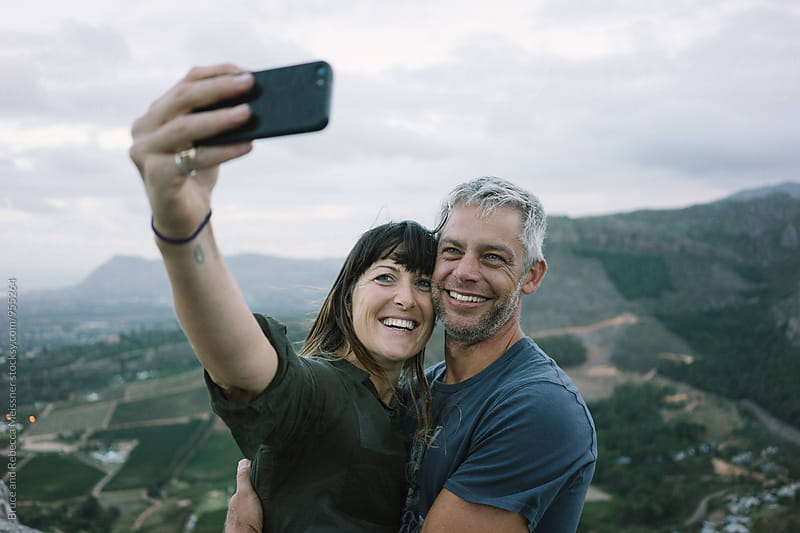 Husband and wife selfie by Bruce and Rebecca Meissner for Stocksy United
